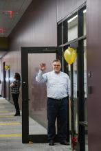 ITS team member Joe Thomas welcomes guests to the Technology Services Building (TSB).