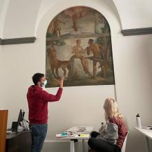 FSU Florence faculty member discusses original mural within the FSU Florence Palazzo Bagnesi with student